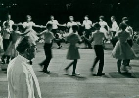 Lunsford presiding over dancers at Pack Square