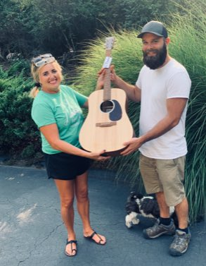 lottery winner with new guitar